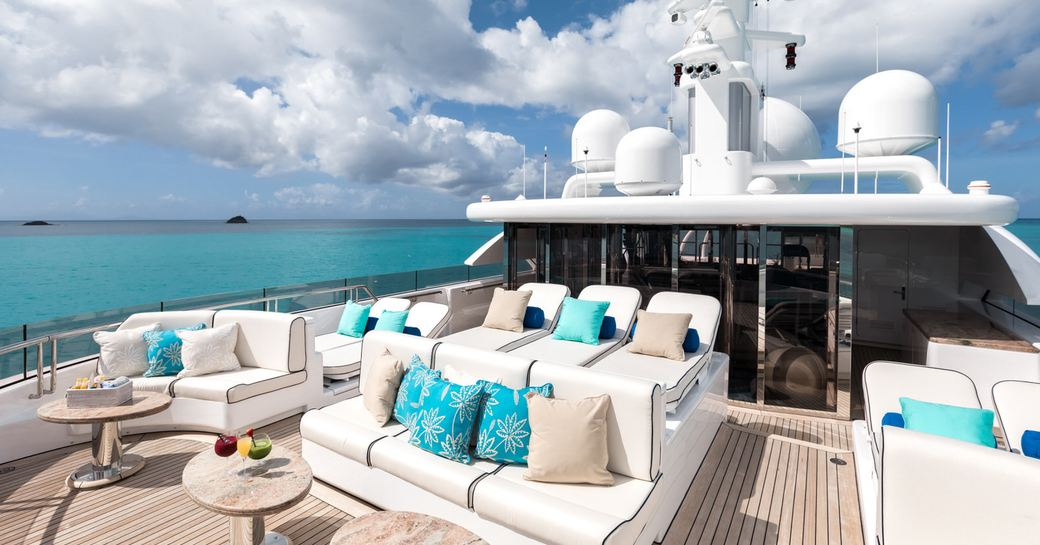 seating and sunning areas on the forward section of the sundeck aboard charter yacht TITANIA