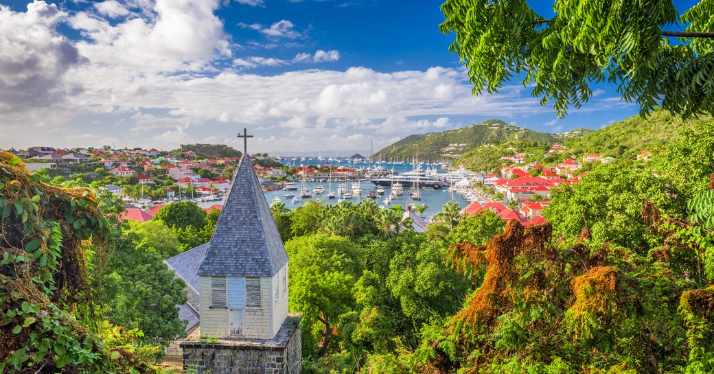 Gustavia Harbour in St Barts as seen from hilltop covered in greenery