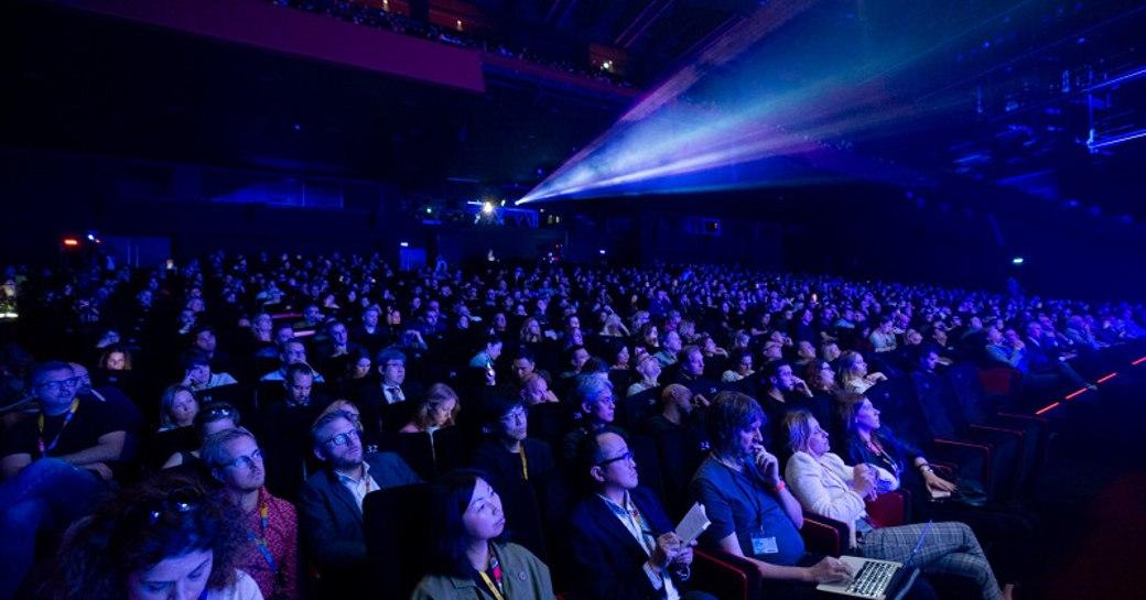 Cinema environment at MIPCOM, audience watching screen.