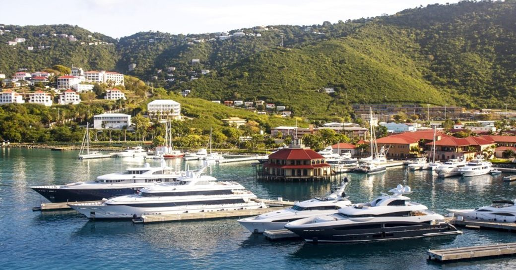 A daytime photo of superyachts gathered in Yacht Haven Grande Marina, St Thomas