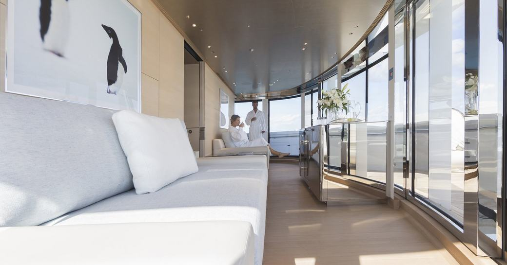 guests in dressing gowns relax in the observation salon aboard superyacht NAUTILUS