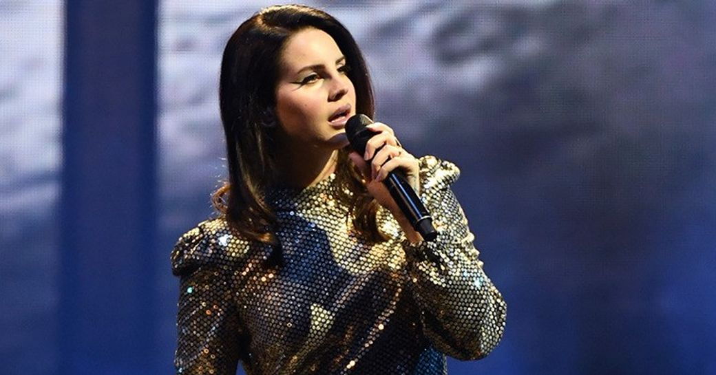 ethereal wonder Lana Del Rey performing in front of a stadium of fans on the main stage of Abu Dhabi Grand Prix