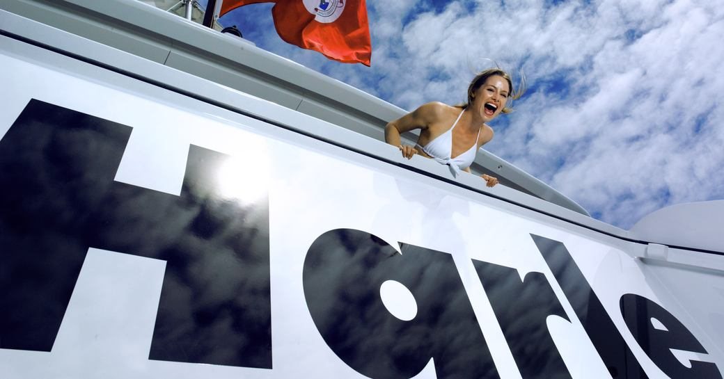 Woman on the deck of luxury yacht HARLE