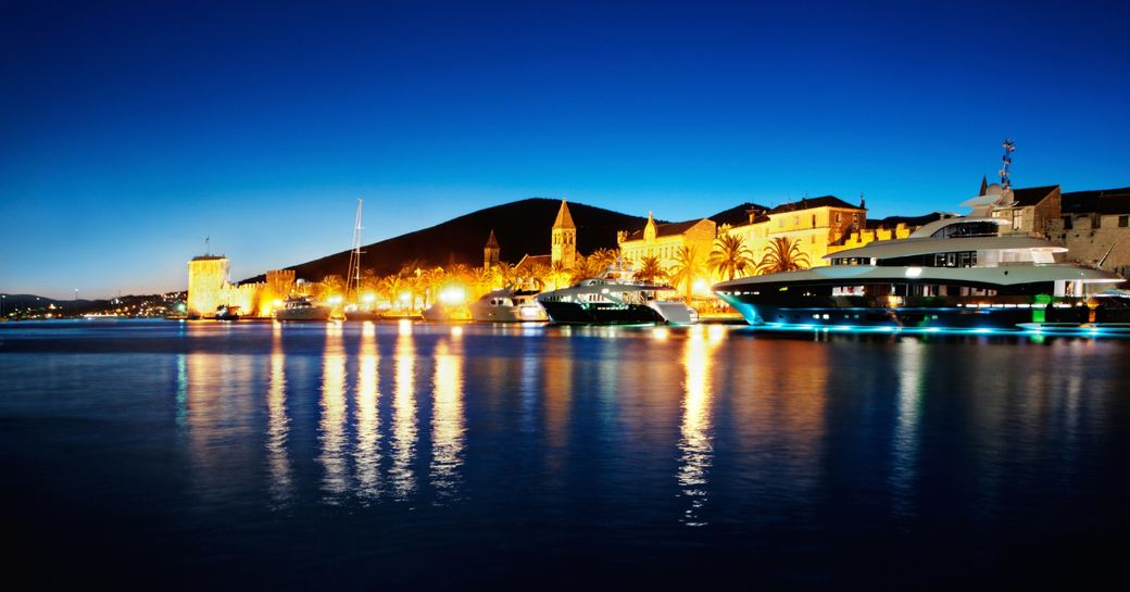 superyachts line up at night in Vis, Croatia
