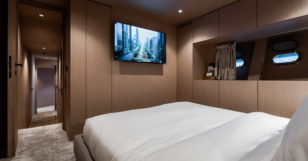 Large double bed looking at TV on charter yacht NEOPRENE