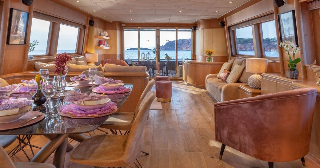 open plan Alcantara salon in luxury charter yacht ANAMEL