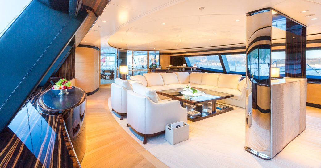 Large sofa and arm chairs forms seating area in the main salon of superyacht Q