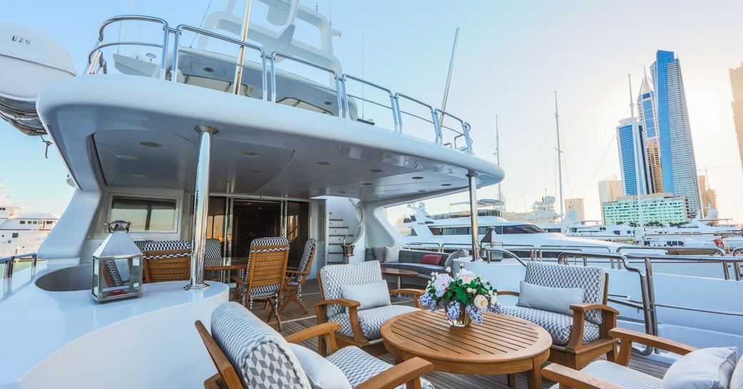 upper deck aft of luxury yacht DXB with lounging area and alfresco dining setup