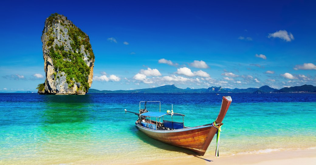 boat moored at beach in thailand