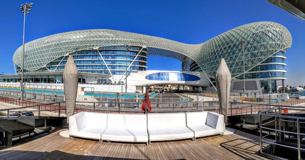 the trackside view of a lucury cuperyacht berthed by the race track at abu dhabi grand prix 2019