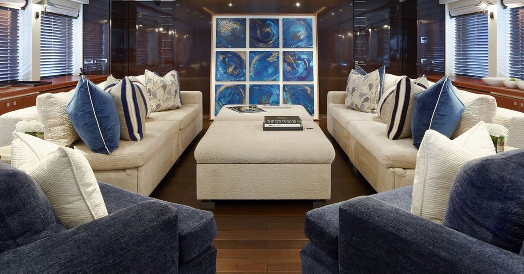 cream sofas and navy armchairs in the main salon aboard motor yacht ROCKET