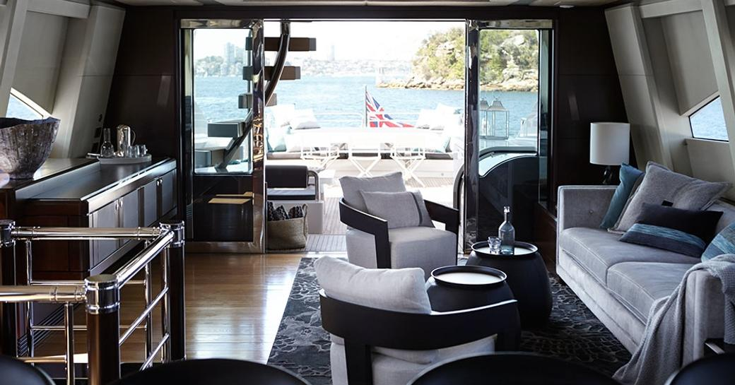 main salon with comfortable lounge on board charter yacht QUANTUM