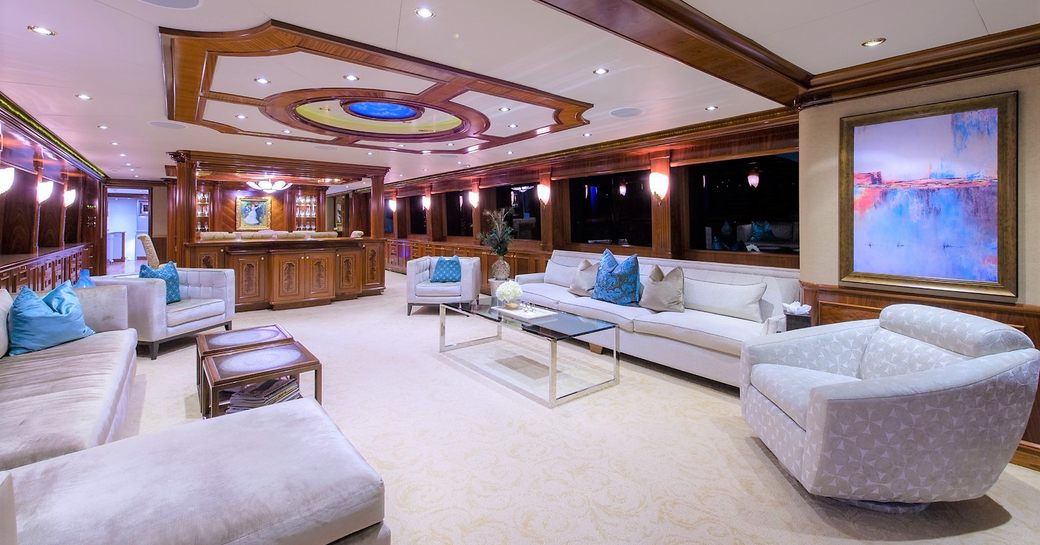 large sofas and armchairs in the main salon aboard motor yacht EXCELLENCE