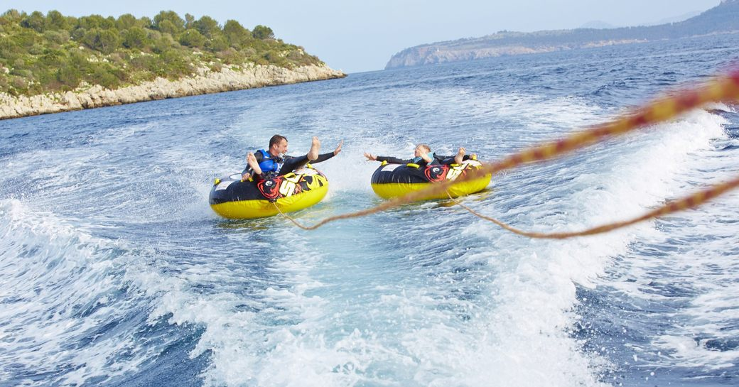 charter guests enjoy inflatable toys on superyacht spirit