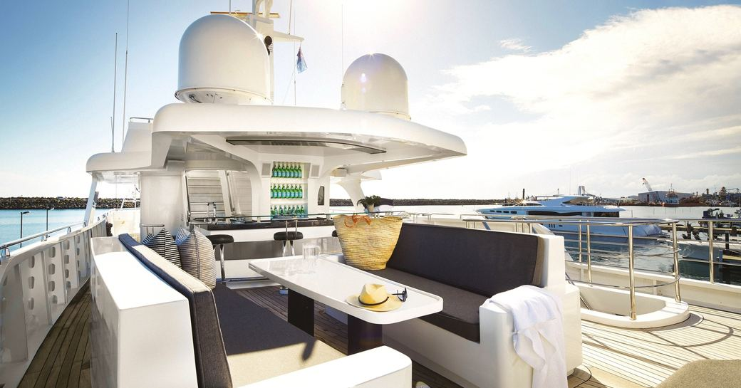 alfresco dining area and bar on sundeck of motor yacht anda