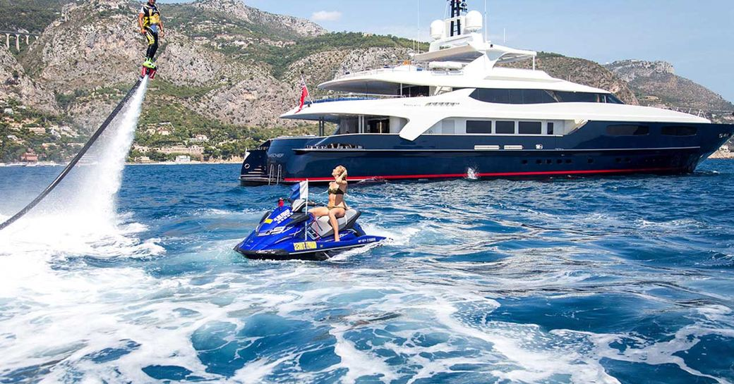 superyacht MISCHIEF docked on charter in the Caribbean as charter guests play on jet ski and jet pack