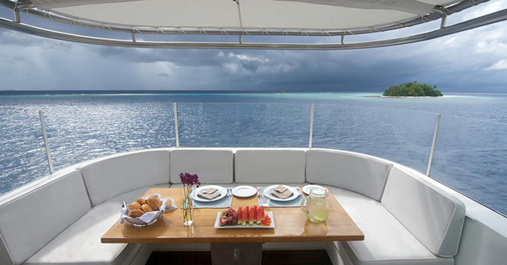 breakfast is served in casual alfresco dining area on board luxury yacht SENSES
