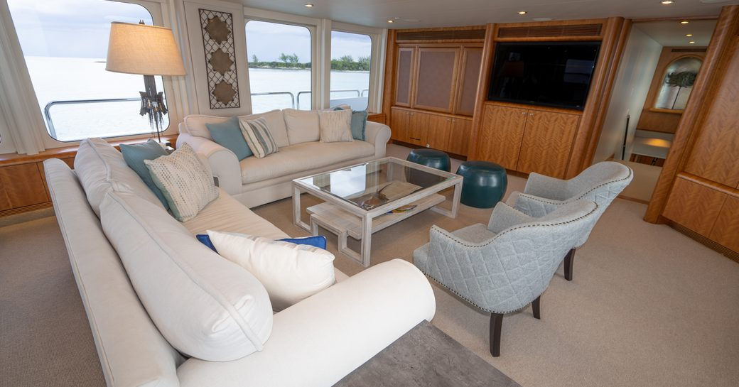 Seating around glass table on superyacht ZEAL