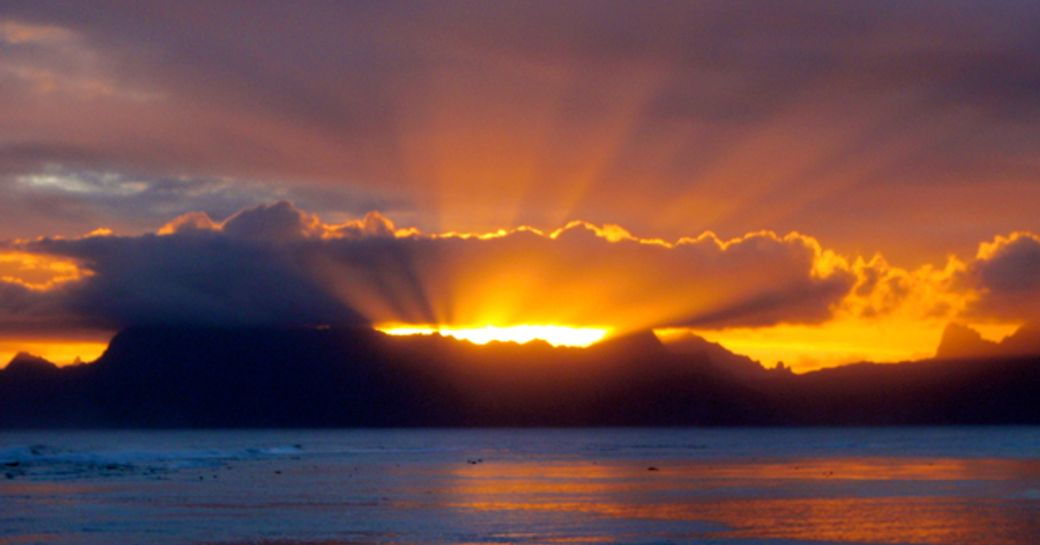 Tahiti is famous for its breathtaking sunsets, best viewed from a charter yacht