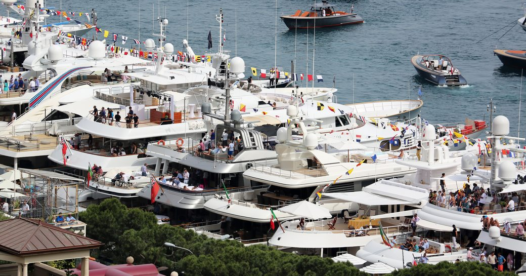 yachts in zone A in Port Hercules decked out in bunting for the Monaco Grand Prix