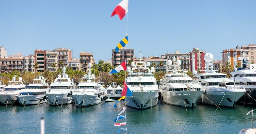 yachts lined up in OneOcean Port Vell in Barcelona for the MYBA Charter Show