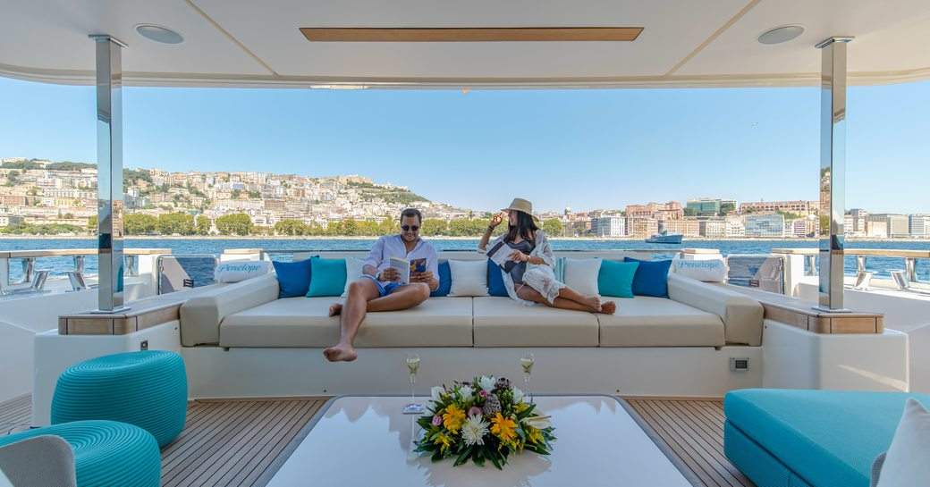 charter guests relax on the deck of custom line yacht penelope