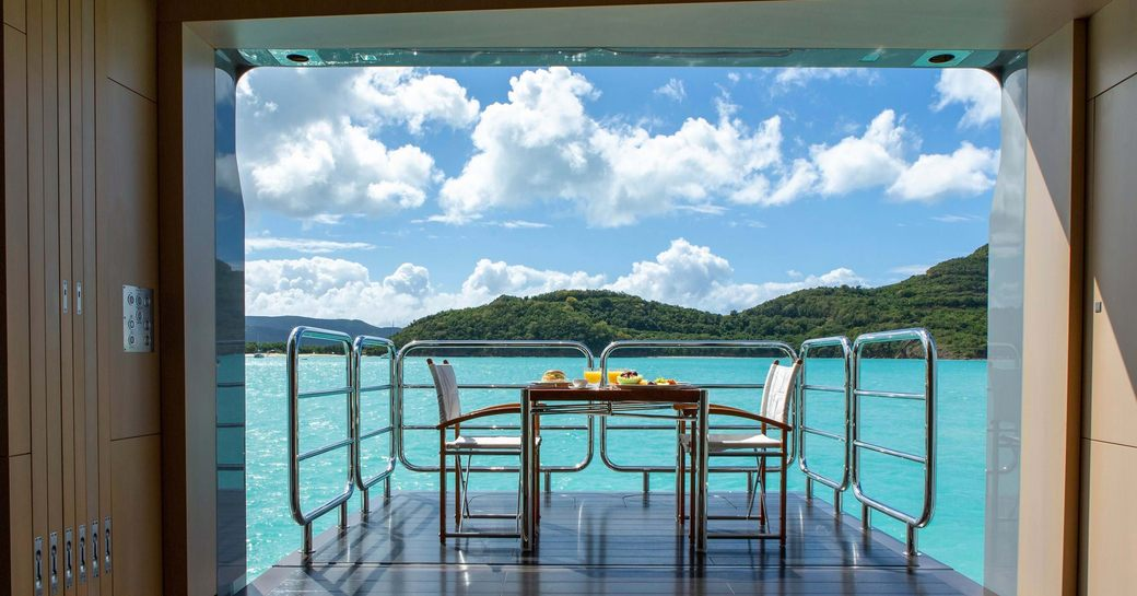 unfolding balcony on superyacht ramble on rose, with tropical caribbean backdrop