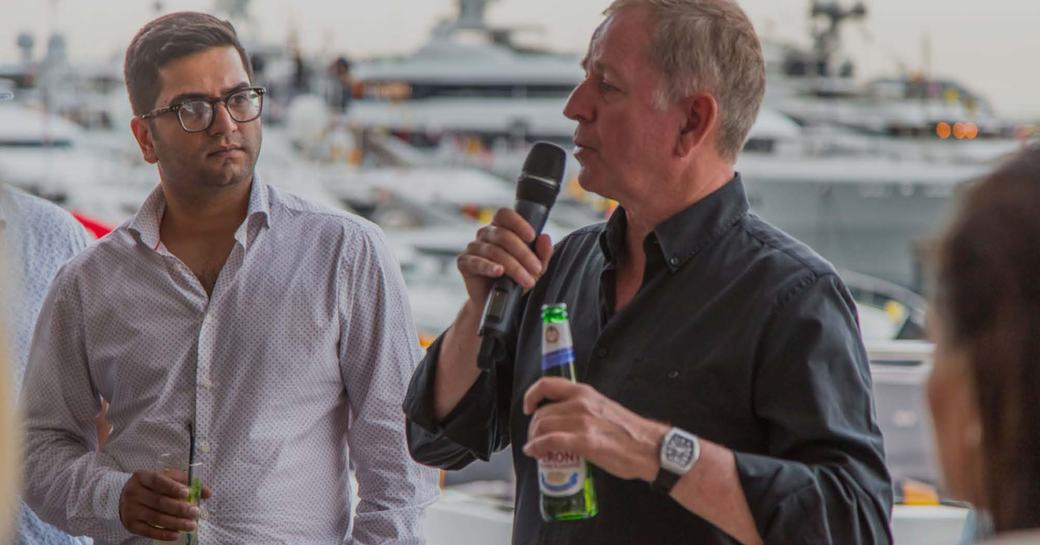 Martin Brundle giving a Q&A session aboard a luxury yacht at the Monaco Grand Prix