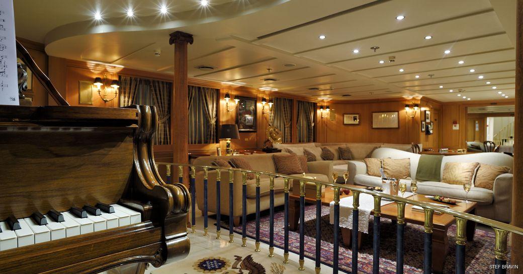 Lounge bar and piano area on board superyacht Christina O