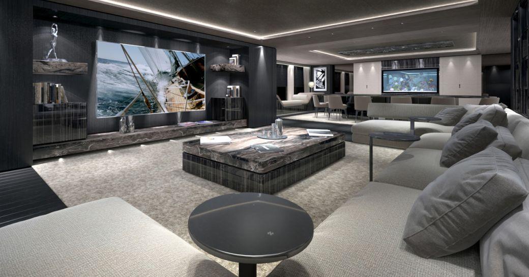 huge U-shaped sofa faces widescreen TV in main salon aboard luxury yacht SOLO