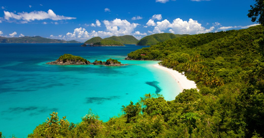 st thomas bay in the us virgin islands, electric blue sea and and bright white sand beach