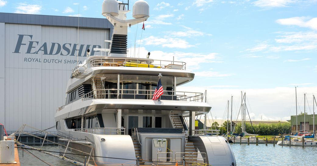Luxury megayacht W aft deck view as she sits outside Feadship facilities
