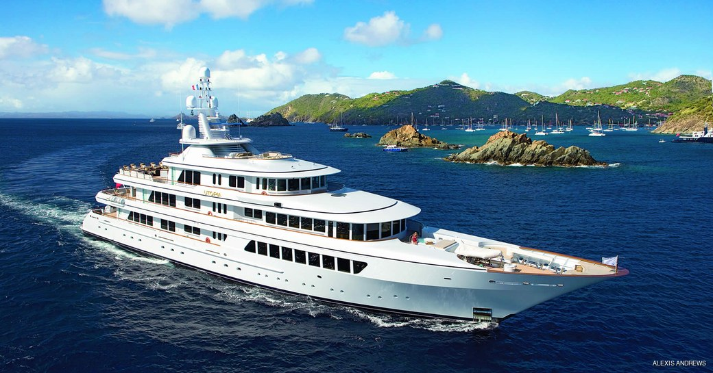 headship superyacht utopia underway in the caribbean, island of st barts in the background