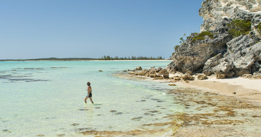 Man wades in shallow water on Cat Island