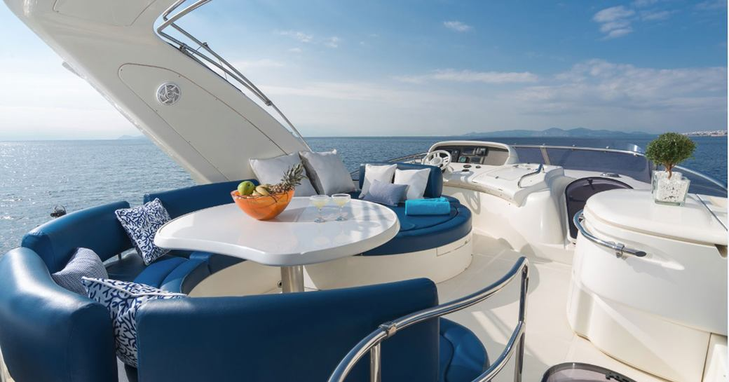 Flydeck dining on charter yacht ALMAZ in Greece