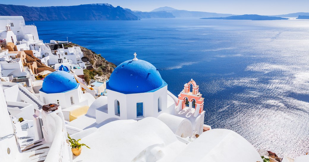blue and white buildings in town of santorini in greece