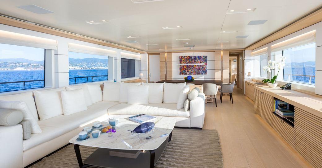 L-shaped, cream sofa in main salon of motor yacht NARVALO