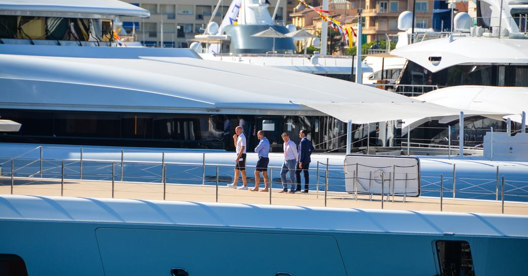 brokers chat on the decks of superyacht aviva during monaco boat show