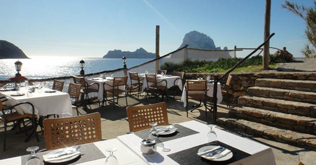 outdoor dining area at Es Boldado, Cala D'Hort in Ibiza