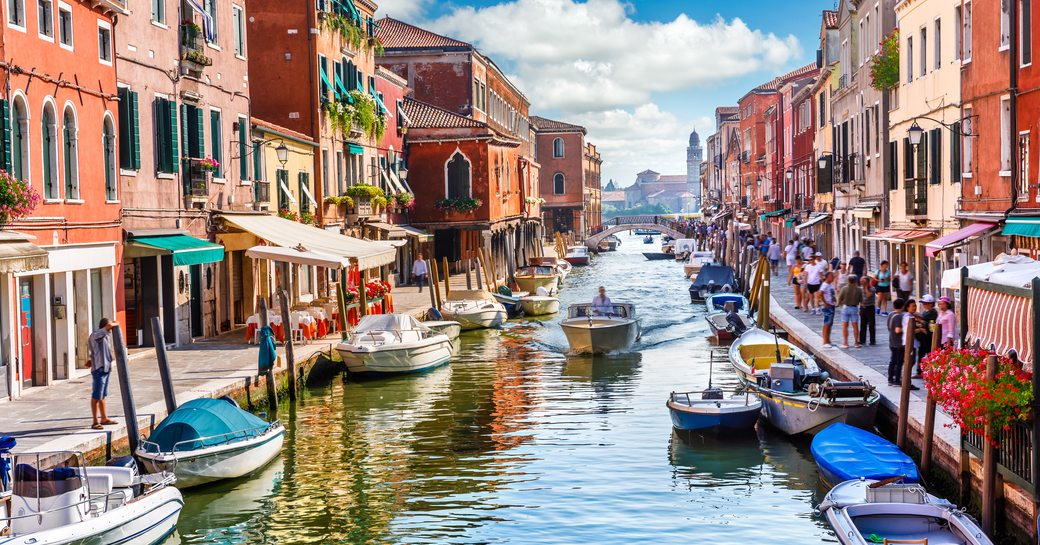 the famous canals of Venice where luxury charter yachts are not allowed to cruise but provides a romantic setting while guests are enjoying their vacation