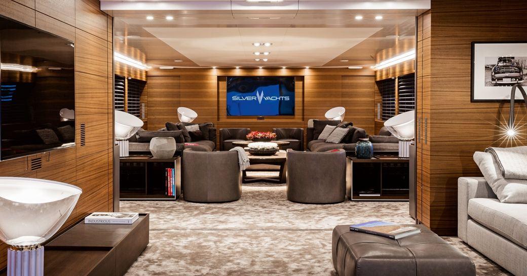 luxurious main salon with open-grain teak aboard superyacht 'Silver Fast'
