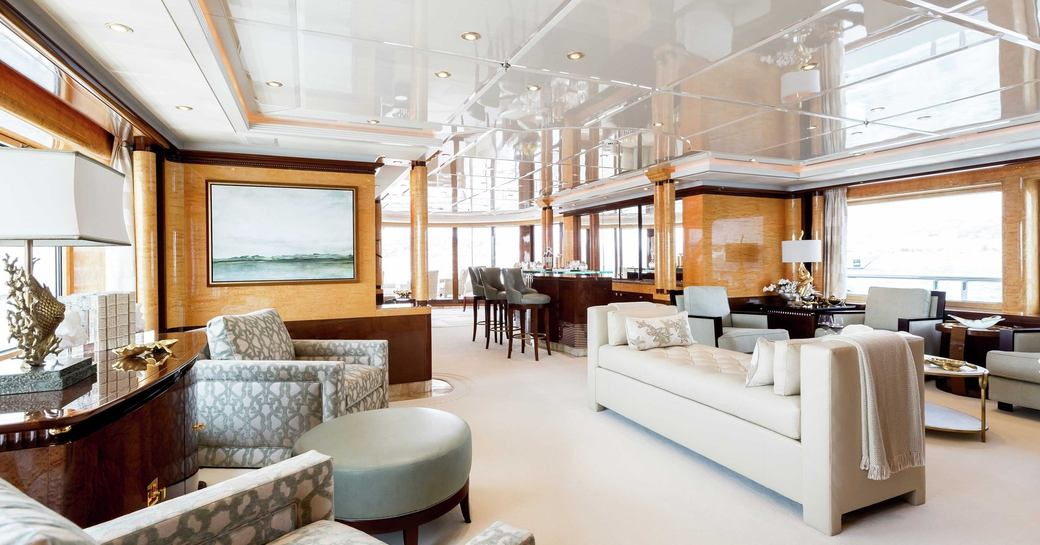 armchairs, sofa and bar in the main salon of luxury yacht Lucky Lady