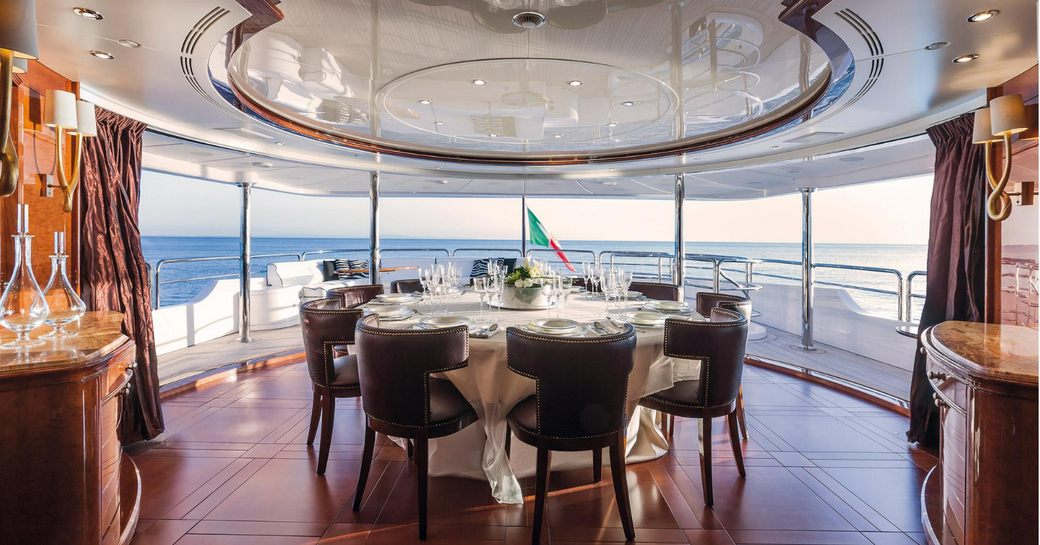 magnificent semi-alfresco dining area on the upper deck aft of motor yacht CHECKMATE