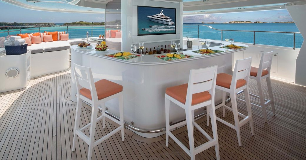 a cocktail bar partitions the sun deck and creates a wonderful social space to unwind with a perfect view of the Caribbean surroundings