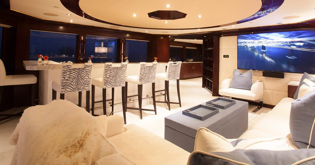 bar and wide-screen TV in skylounge aboard superyacht TRENDING
