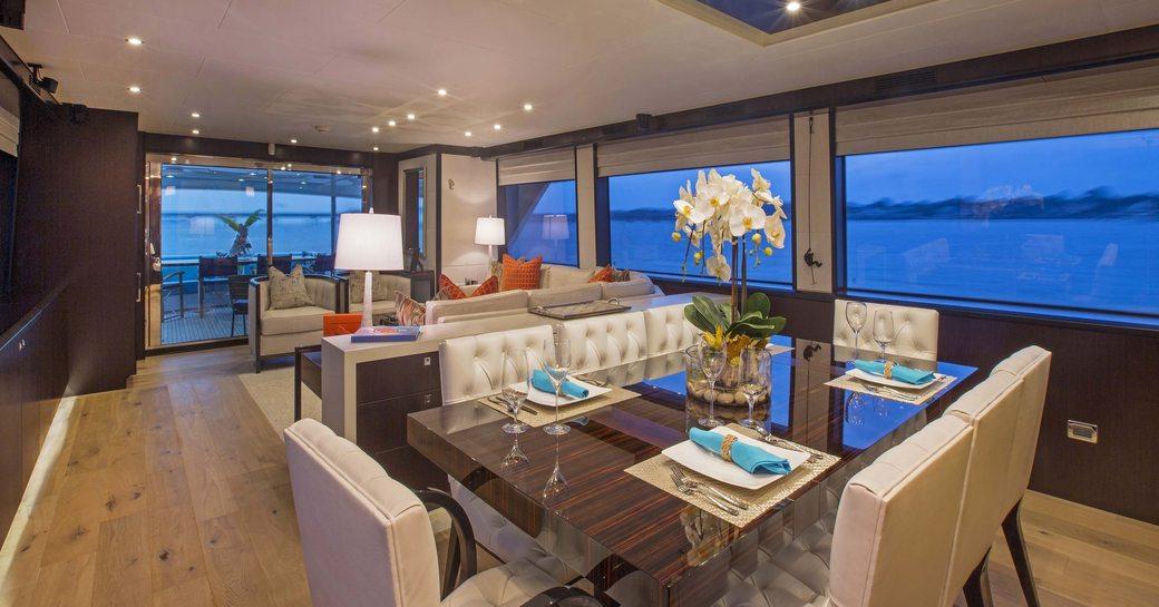 high-gloss dining table in main salon of superyacht 'Lady Carmen'