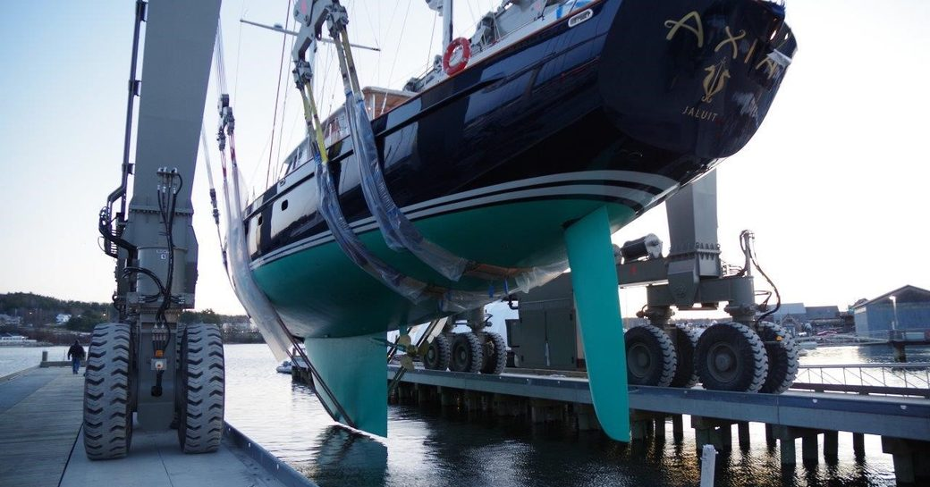 Sailing yacht Axia in travel lift preparing to be launched