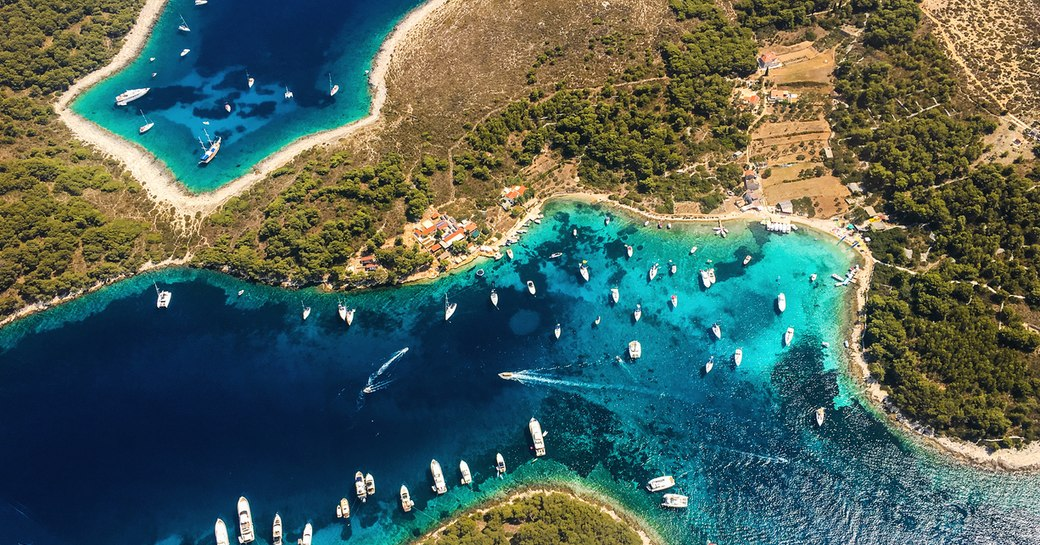islands of croatia, aerial view with bright blue water and yachts
