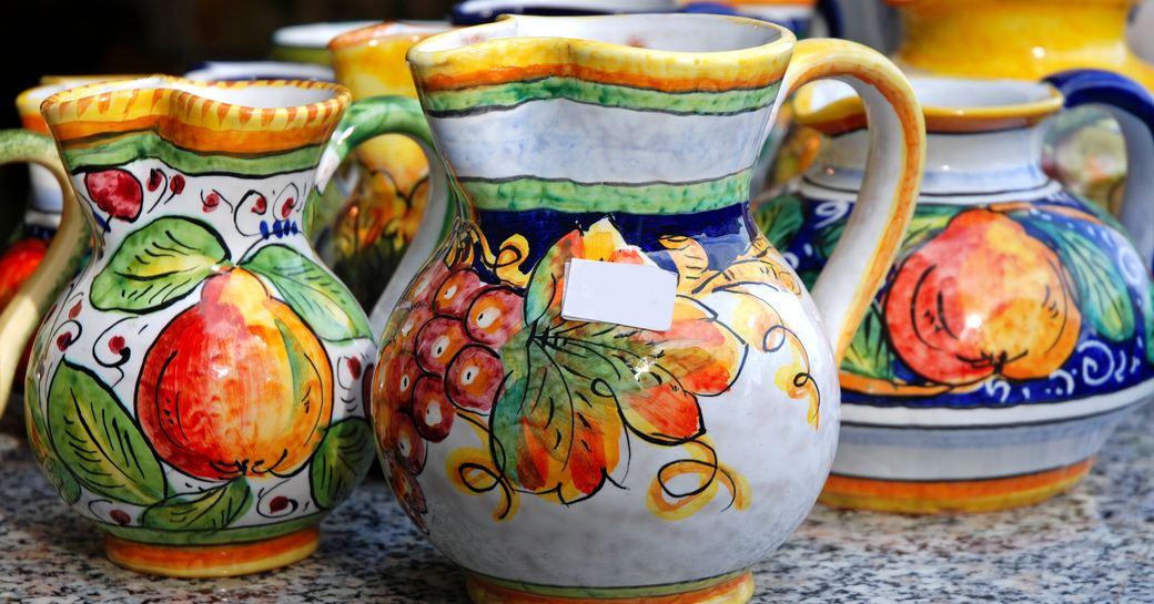 painted ceramic jugs at little shop on italy's amalfi coast