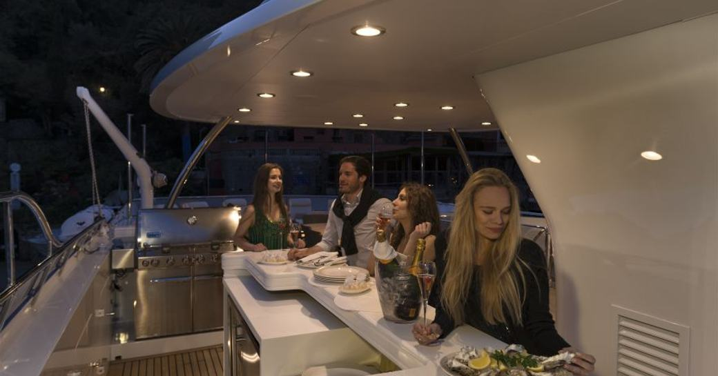 guests enjoying a decadent meal after a day of cruising mallorca on board charter yacht the wellington which is staring in the hit tv series below deck mediterranean